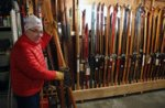 Greg Fangel stores his extensive ski collection on a wooden rack in his garage.Above: Some of the older skis in Fangel's collection were manufactured in Norway. These skis date from about 1926.