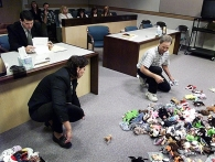 Frances Mountain, left, sorts out Beanie Babies with her ex-husband, Harold Mountain, in a Las Vegas courtroom in 1999. The couple was unable to split the collection by themselves, so they spread it on the courtroom floor and divided it up under the judge's supervision. Maple the Bear was the first to go.